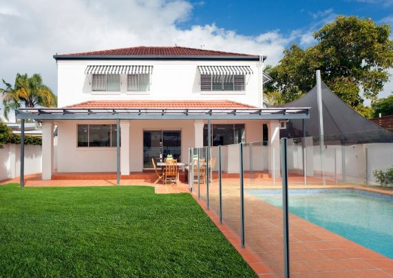 beautiful home with a pool and a glass pool fence | Ballarat Fencing Pros